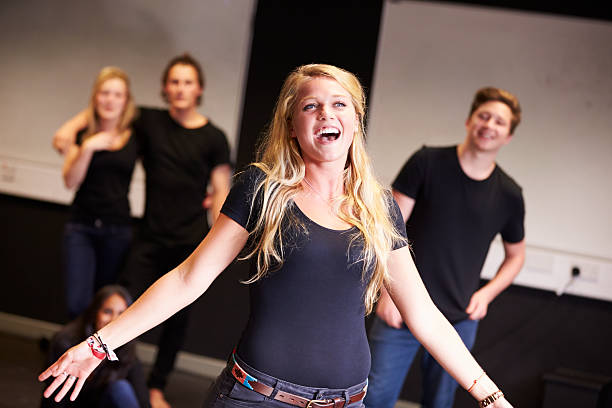 Students Taking Singing Class At Drama College Students Taking Singing Class At Drama College. Student Singing performing arts event stock pictures, royalty-free photos & images