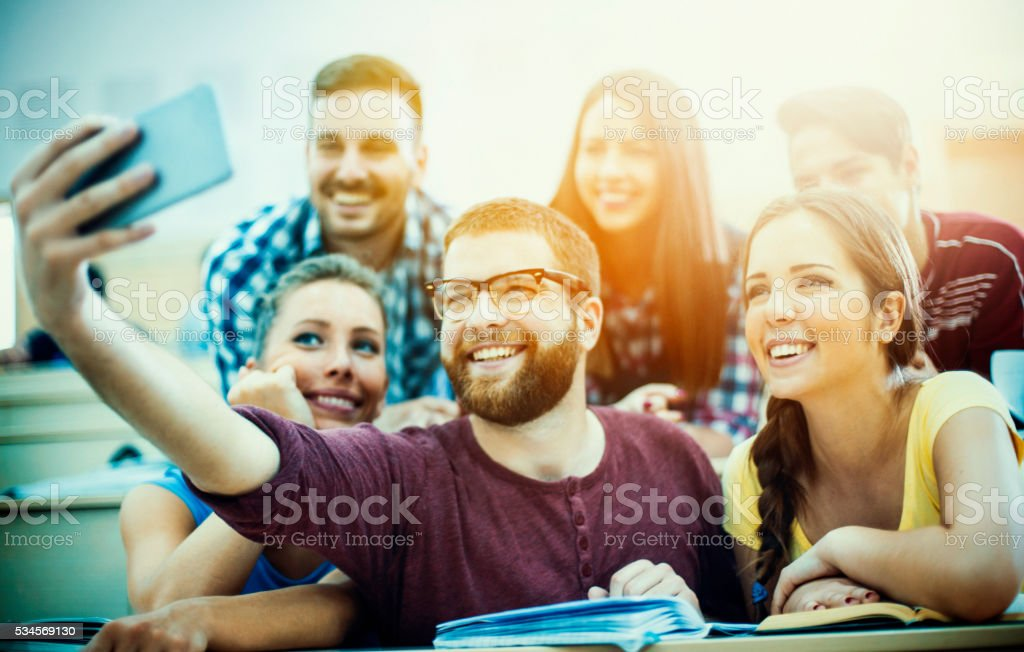 Students taking some selfies before class. stock photo