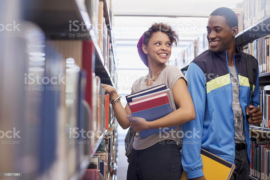 Students talking in library stock photo