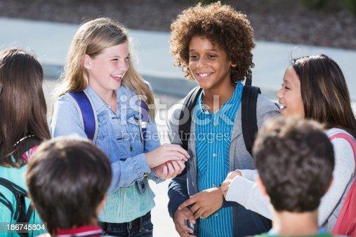 istock Students talking outdoors 186745804