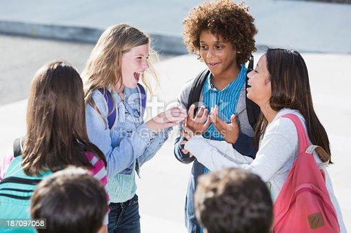 istock Students talking outdoors 187097058