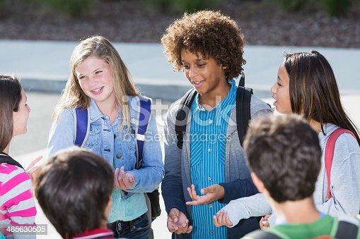 istock Students talking outdoors 465630505