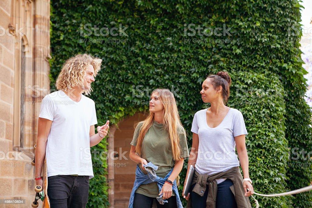 students talking stock photo