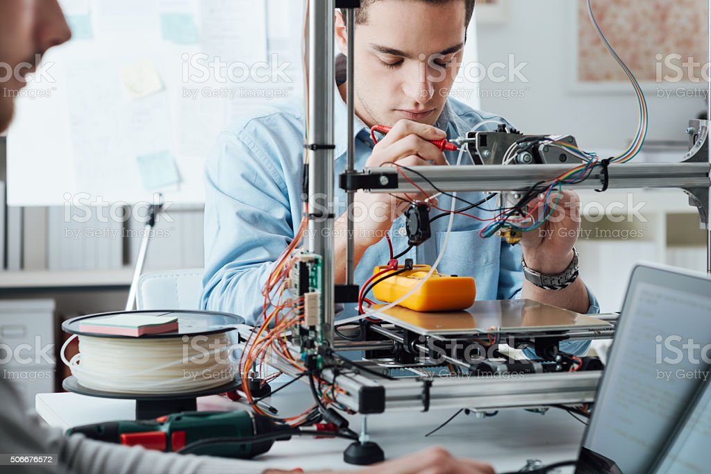 Students using a 3D printer stock photo