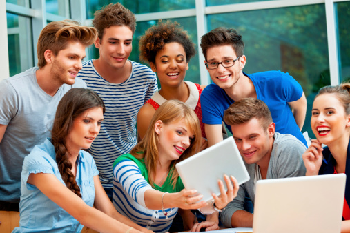 Students Using A Digital Tablet Stock Photo - Download Image Now