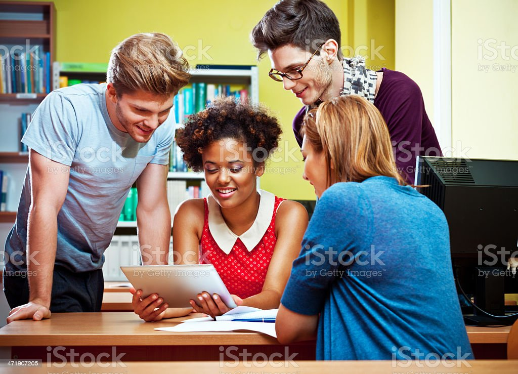 Students using a digital tablet royalty-free stock photo