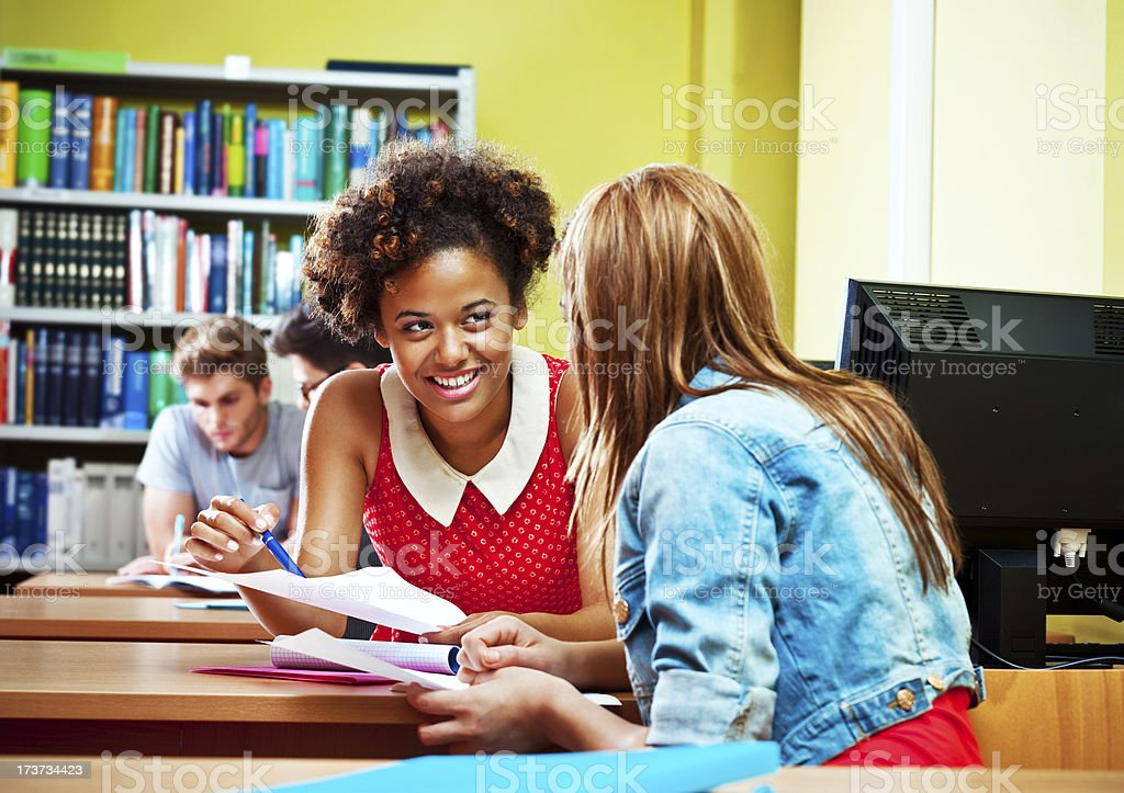 Students using a library royalty-free stock photo