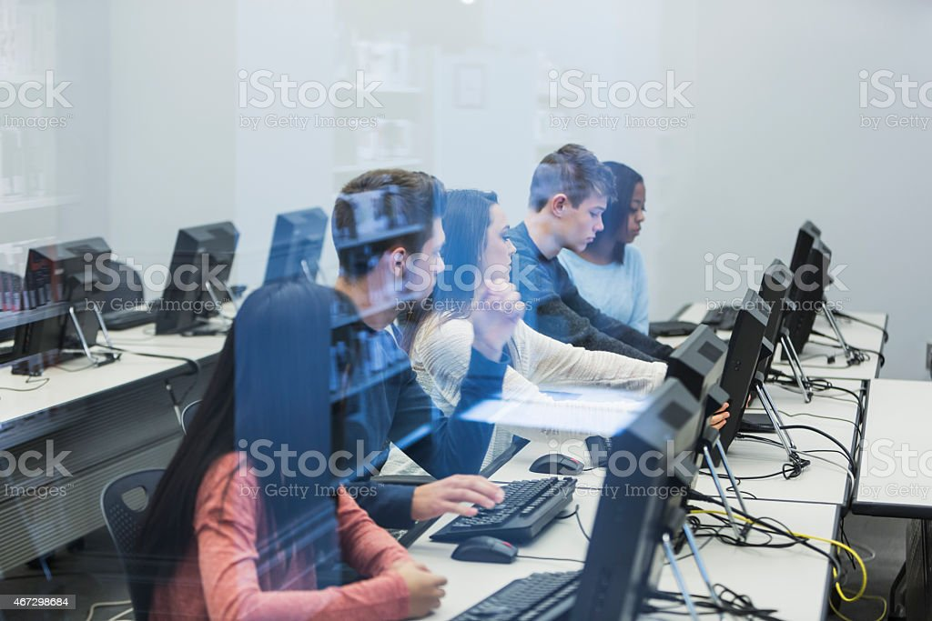Students using computers stock photo