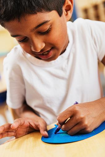 Students Using Crayons