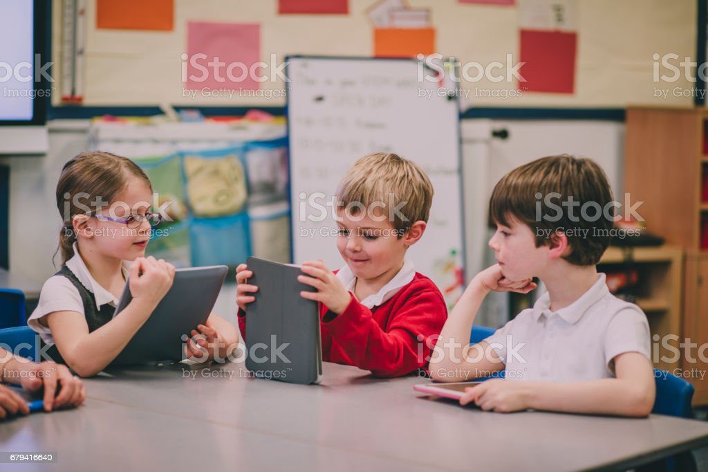Students Using Digital Tablet royalty-free stock photo
