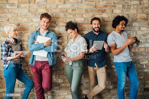 istock Students using technology and smiling 1144861690