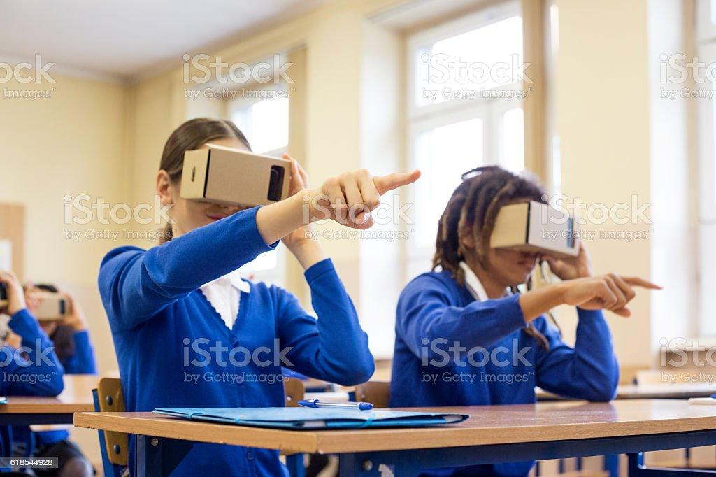 Students using virtual reality goggles royalty-free stock photo