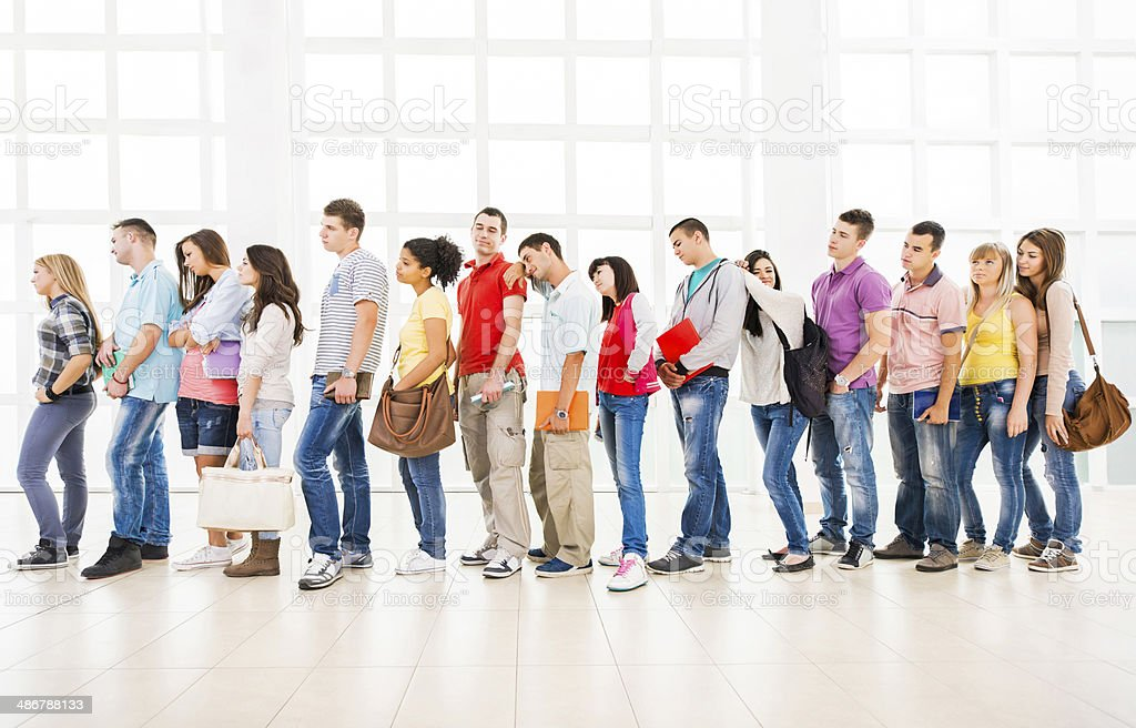 Students waiting in a line. stock photo
