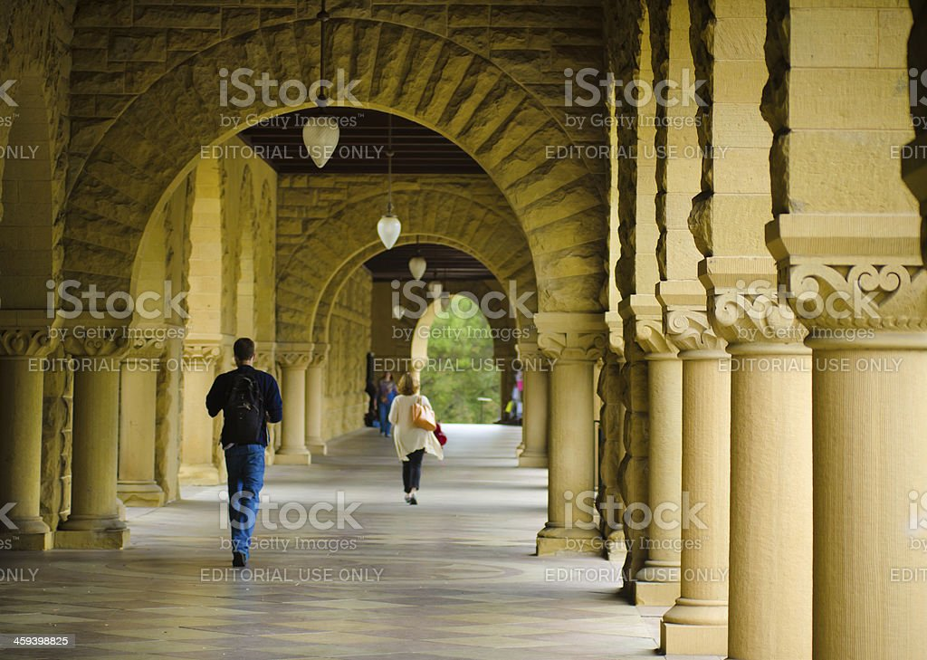 Students walk along covered footpath at Stanford University stock photo