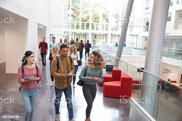 Students walk and talk using mobile devices in university picture id597958786?b=1&k=6&m=597958786&s=612x612&h=p3uaqecalzcdgtexqhdyuao3nytvvoonfcf hbqg688=