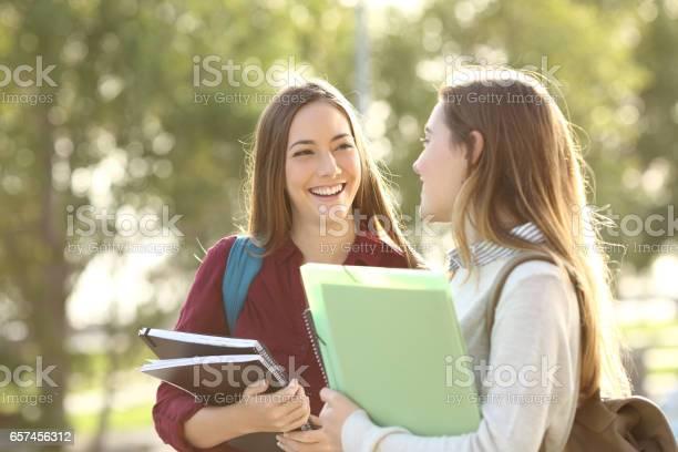 Students walking and talking in a campus picture id657456312?b=1&k=6&m=657456312&s=612x612&h=qtpe bfgtjoxb02ncmvisd1xkwrrx rjxldmhe9klza=