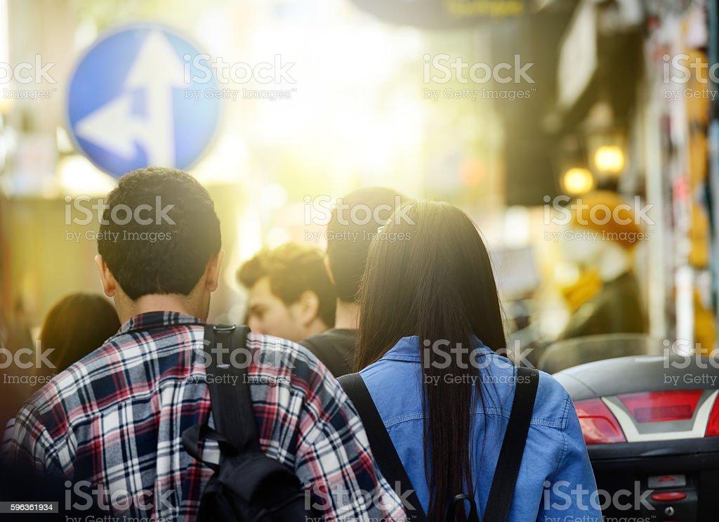 Students walking on sidewalk royalty-free stock photo