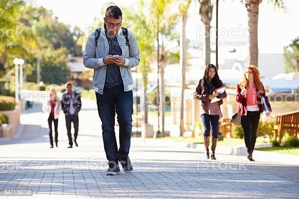 Students walking outdoors on university campus picture id547139208?b=1&k=6&m=547139208&s=612x612&h=x5 vmt1ff3y9ywh9jjcckfpqarbxjs4i8bifug9jjzq=