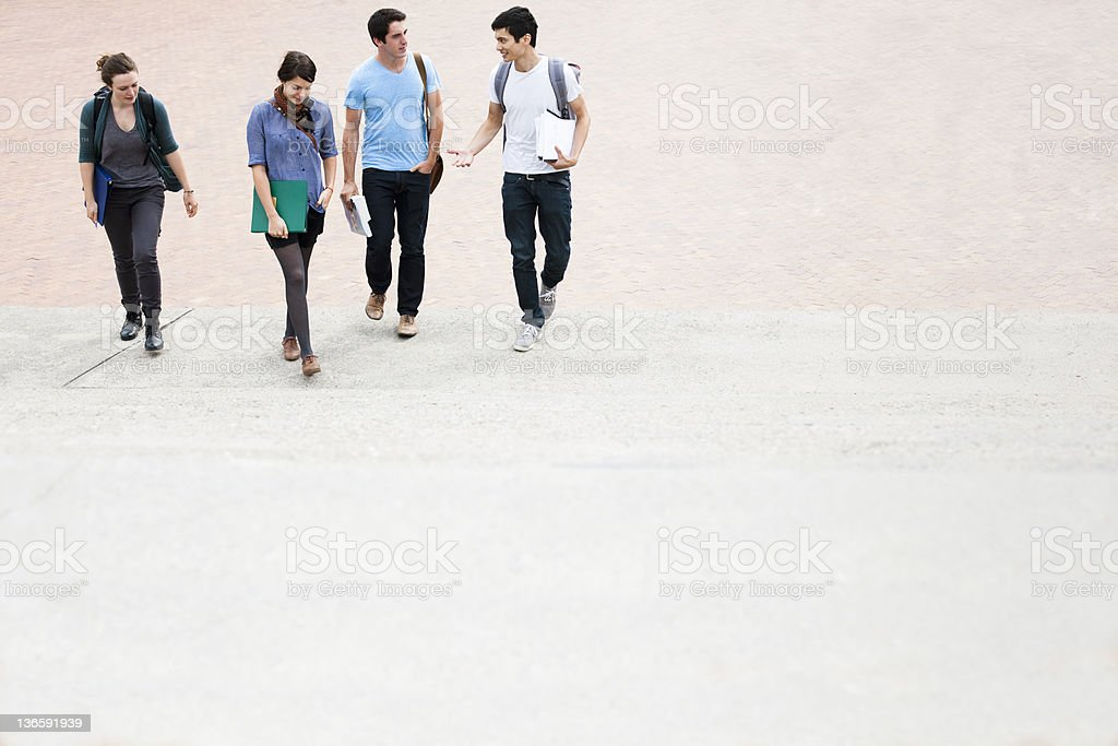 Students walking outdoors stock photo