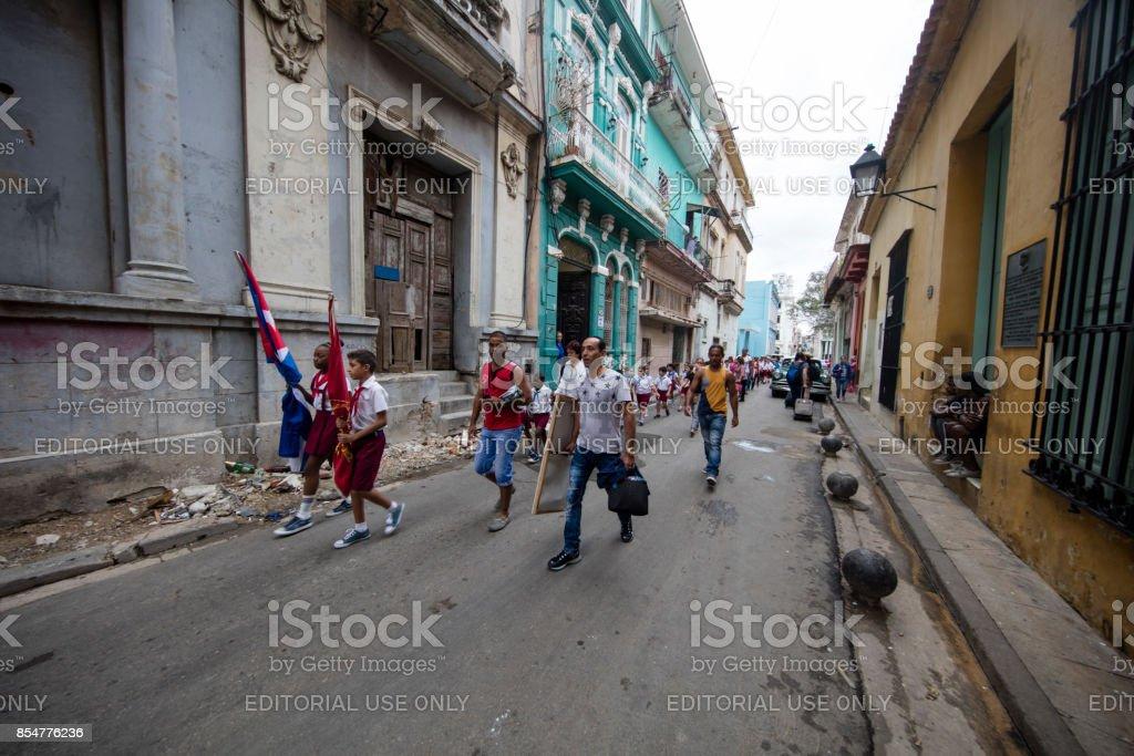 Students walking though the  Street of havana, cuba stock photo