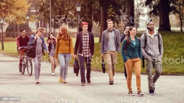 Students walking through the park picture id690165678?b=1&k=6&m=690165678&s=612x612&h=qzor j8u8llhfdup7kpzn2suiryi4hmm5 acrri7f28=