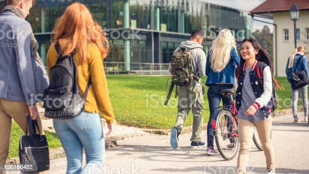 Students walking through the park picture id690166452?b=1&k=6&m=690166452&s=612x612&h=m db3bd94xpot9gczbw judlpft iuc4qma2shxz xq=