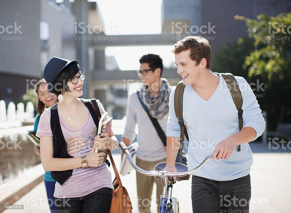 Students walking together outdoors stock photo