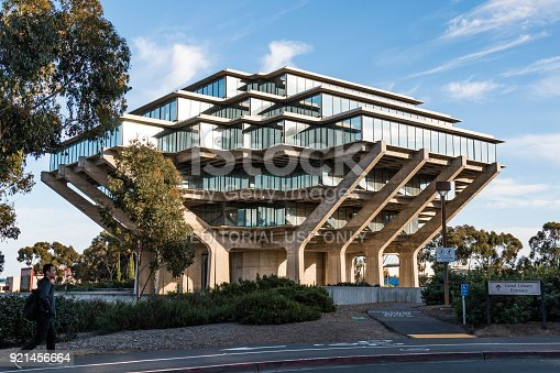 La Jolla, California - February 17, 2018:  Student walks by the Geisel Library at University of California San Diego (UCSD), named in honor of Audrey and Theodor Geisel (Dr. Seuss), and built in 1970.