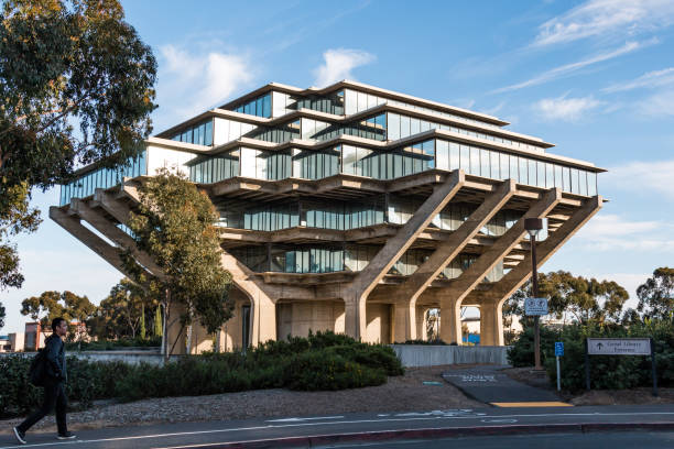 Students Walks By the Geisel Library at UCSD stock photo