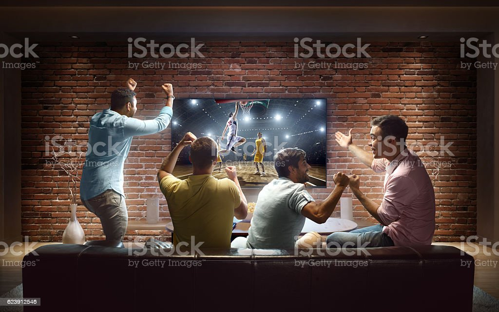 Students watching Basketball game at home stock photo