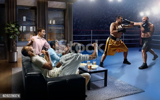:biggrin:A group of young male friends are cheering while watching Boxing at home. They are sitting on a sofa in the modern living room faced to a boxing arena instead of the front wall.