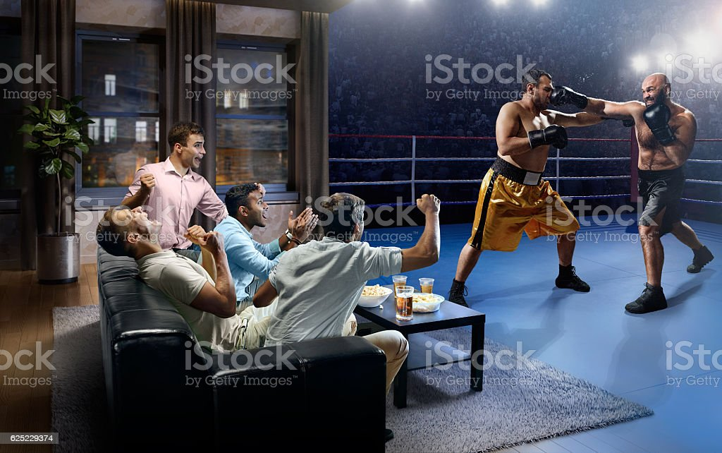 Students watching Boxing at home stock photo
