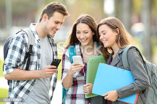 istock Students watching media in their smart phones 1055139868