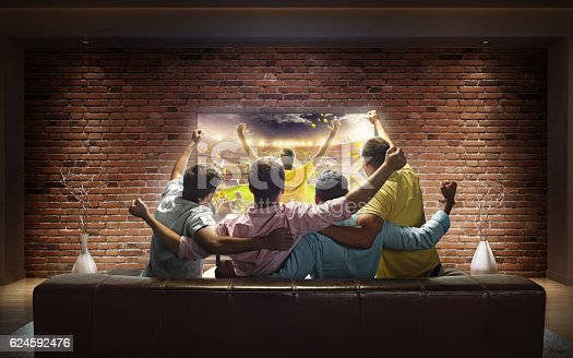istock Students watching Sport game at home 624592476