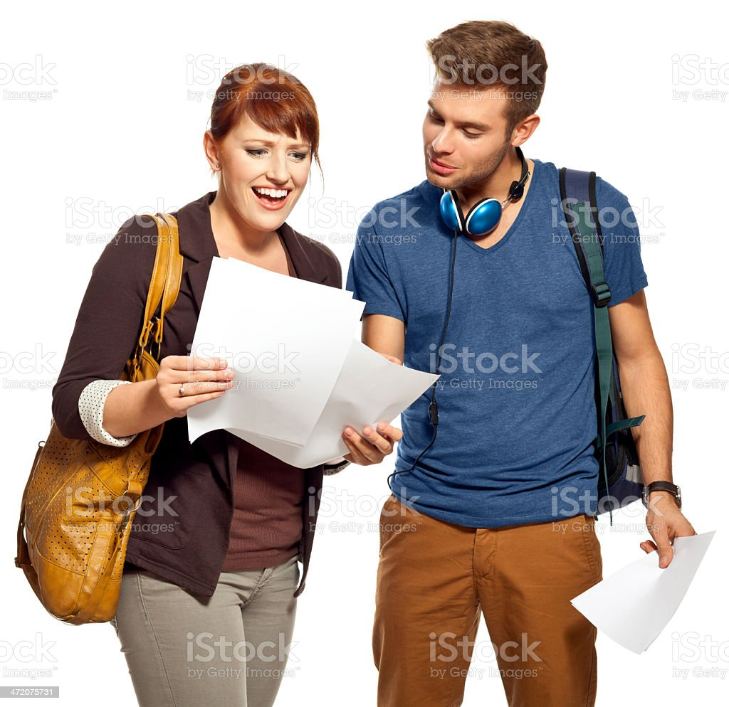Students watching tests Two happy students watching their test results . Studio shot, white background. 18-19 Years Stock Photo
