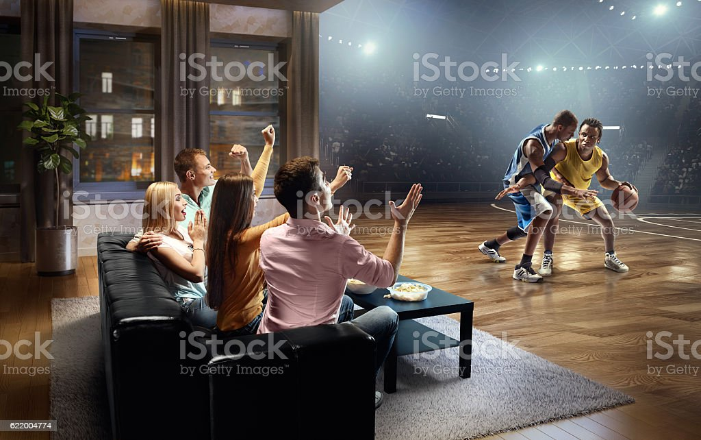 Students watching very realistic Basketball game at home stock photo