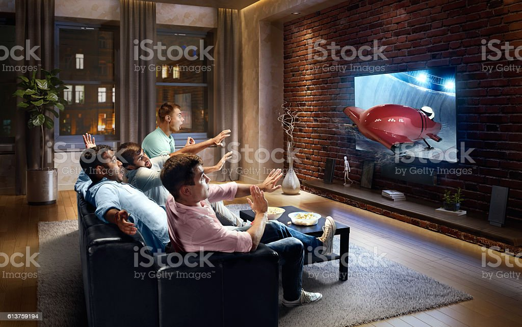 Students watching very realistic Bobsleigh competition on TV stock photo
