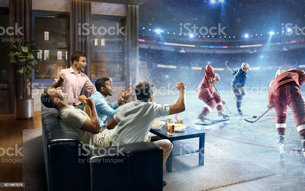 Students watching very realistic Ice hockey game at home stock photo