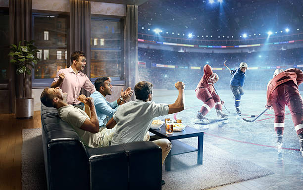 students watching very realistic ice hockey game at home - ホッケー ストックフォトと画像