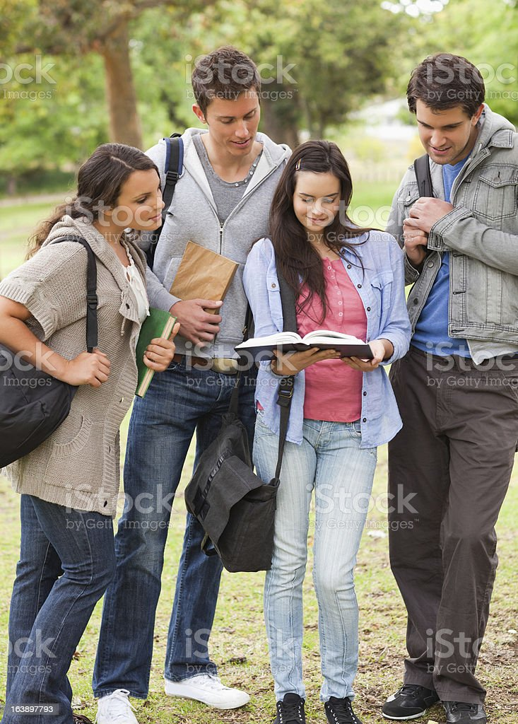 Students with books studying royalty-free stock photo