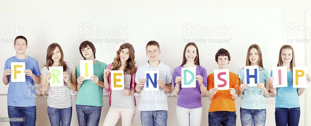 Students with  FRIENDSHIP message on placards. royalty-free stock photo
