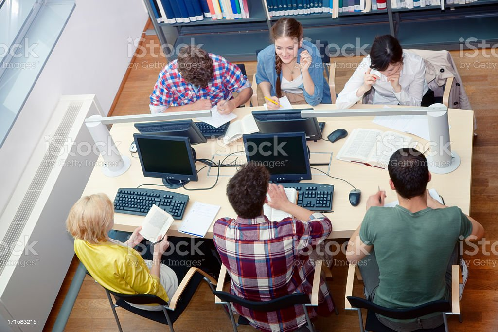 Students Working at Library Table, High Angle View royalty-free stock photo
