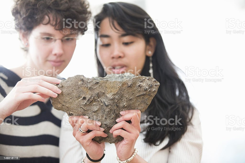 Students working in geology lab stock photo