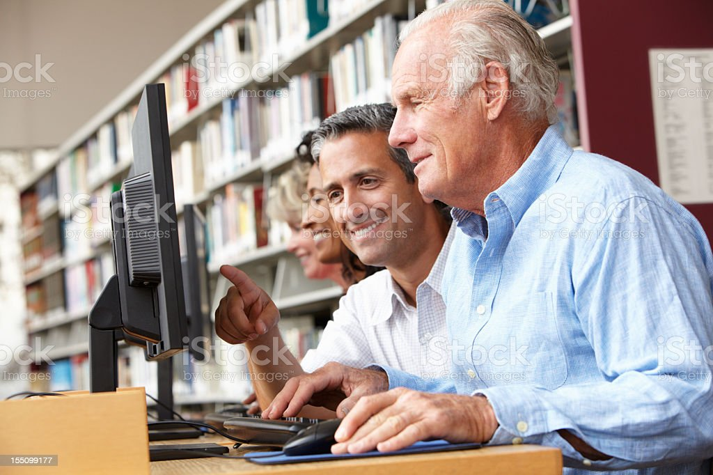 Students working on computers in library royalty-free stock photo