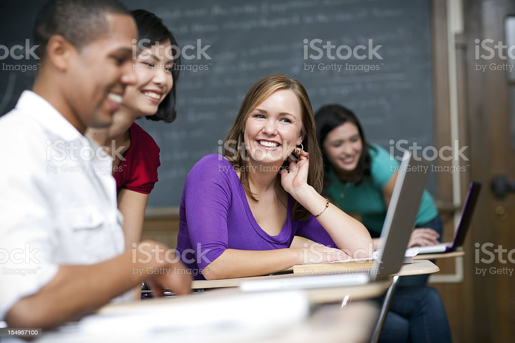 Students working on laptops in a classroom royalty-free stock photo