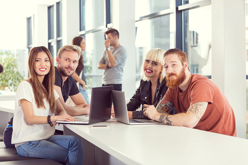 Students Working Together On Laptops At The University Stock Photo - Download Image Now