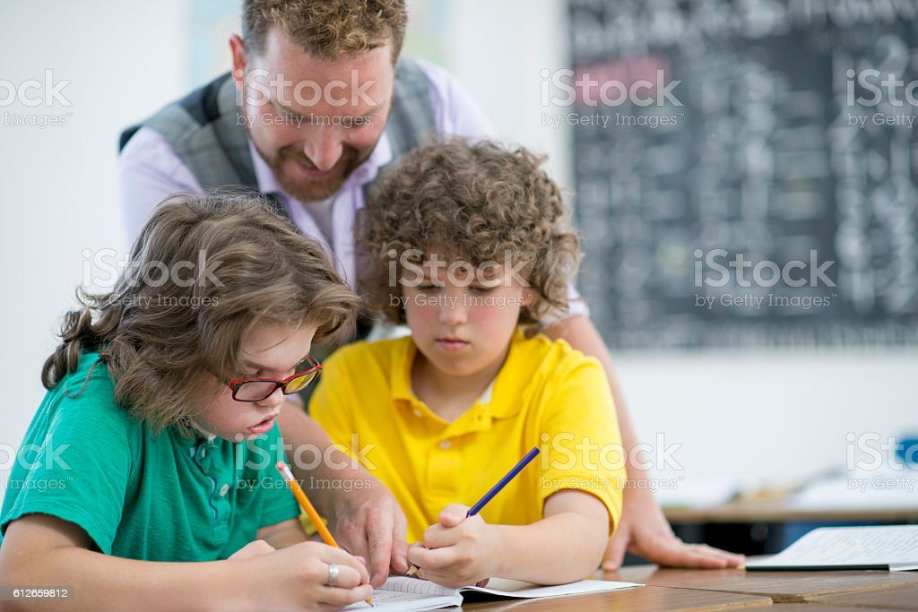 Students Working with a Tutor stock photo
