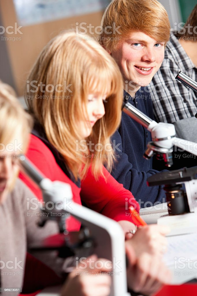 Students working with microscopes royalty-free stock photo