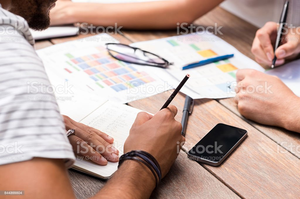 Students writing notes stock photo