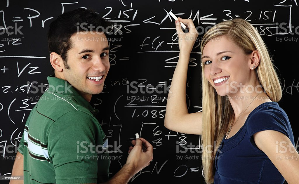 Students Writing on a Blackboard royalty-free stock photo